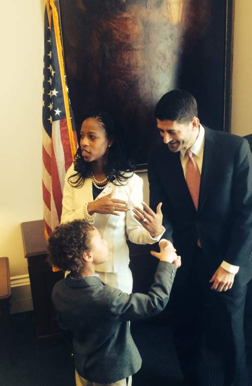 Thomas Burr  |  The Salt Lake Tribune Rep. Mia Love, R-Utah, chats as Rep. Paul Ryan, R-Wisc., shakes hands with Love's son, Peyton, on Tuesday ahead of the swearing in ceremony for new members of Congress. Love is the first black, female Republican member of Congress and is already attracting attention -- and even a kiss on the cheek by Speaker John Boehner -- on her first day.