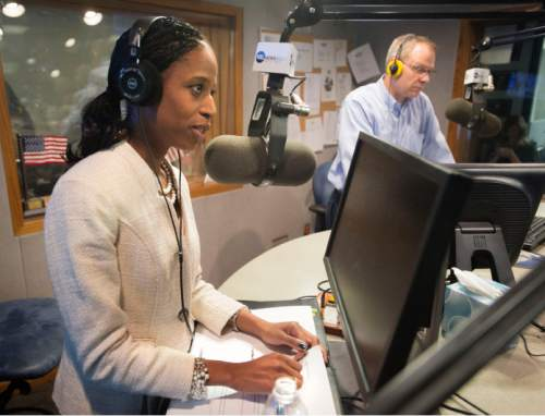 Steve Griffin  |  The Salt Lake Tribune   Mia Love answers a question as she debates her 4th district opponent, Doug Owens, on the Doug Wright Show at the KSL studios in Salt Lake City, Thursday, October 30, 2014.