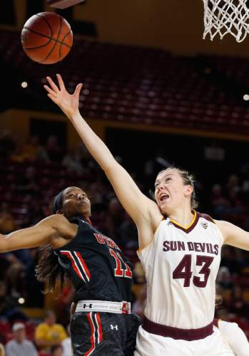 Arizona State's Eliza Normen (43) jumps for a rebound in front of Utah's Erika Bean (11) during the first half of an NCAA college basketball game Sunday, Jan. 17, 2016, in Tempe, Ariz. (AP Photo/Ross D. Franklin)