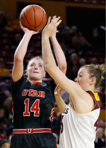 Utah's Paige Crozon (14) shoots over Arizona State's Eliza Normen, right, during the first half of an NCAA college basketball game Sunday, Jan. 17, 2016, in Tempe, Ariz. (AP Photo/Ross D. Franklin)