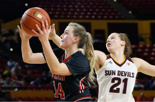 Utah's Paige Crozon (14) goes in to score as she drives past Arizona State's Sophie Brunner (21) during the first half of an NCAA college basketball game Sunday, Jan. 17, 2016, in Tempe, Ariz. (AP Photo/Ross D. Franklin)