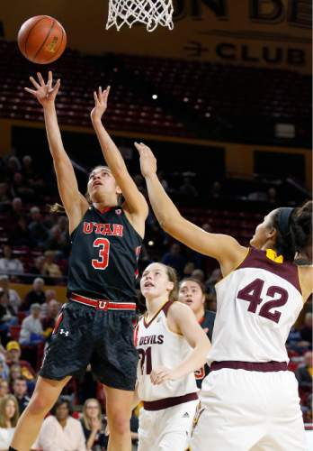 Utah's Malia Nawahine (3) gets past Arizona State's Kianna Ibis (42) and Sophie Brunner (21) to score during the first half of an NCAA college basketball game Sunday, Jan. 17, 2016, in Tempe, Ariz. (AP Photo/Ross D. Franklin)