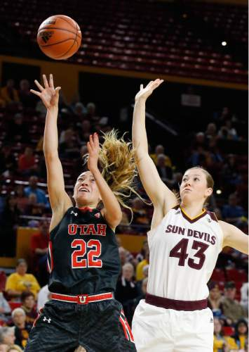 Utah's Danielle Rodriguez (22) drives past Arizona State's Eliza Normen (43) to score during the first half of an NCAA college basketball game Sunday, Jan. 17, 2016, in Tempe, Ariz. (AP Photo/Ross D. Franklin)