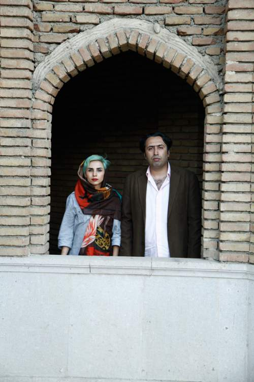 In this undated photo made available by the International Campaign for Human Rights in Iran, Iranian poets Fatemeh Ekhtesari , left, and Mehdi Mousavi pose in an unknown place in Iran. The two poets who face lashings and prison sentences have fled Iran, one of the writers said Monday, a rare escape for local artists and activists ensnared in an ongoing crackdown on expression in the country. (International Campaign for Human Rights in Iran via AP)