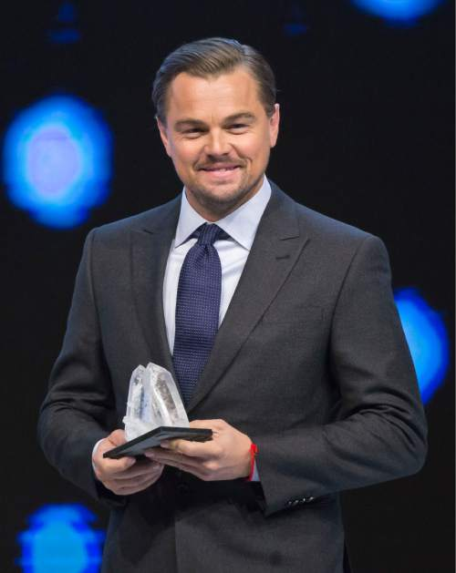 US Actor Leonardo DiCaprio smiles as he was awarded the Crystal Awards during the World Economic Forum in Davos, Switzerland, Tuesday Jan. 19, 2016. The world's political and business elite are being urged to do more than pay lip service to growing inequalities around the world as they head off for this week's World Economic Forum in the Swiss ski resort of Davos this week. (AP Photo/Michel Euler)