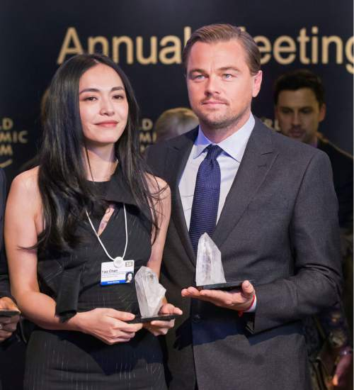 Chinese actress Yao Chen, left, and US Actor Leonardo DiCaprio pose with their trophies for media after Crystal Awards ceremony at the World Economic Forum in Davos, Switzerland, Tuesday Jan. 19, 2016. The world's political and business elite are being urged to do more than pay lip service to growing inequalities around the world as they head off for this week's World Economic Forum in the Swiss ski resort of Davos this week. (AP Photo/Michel Euler)