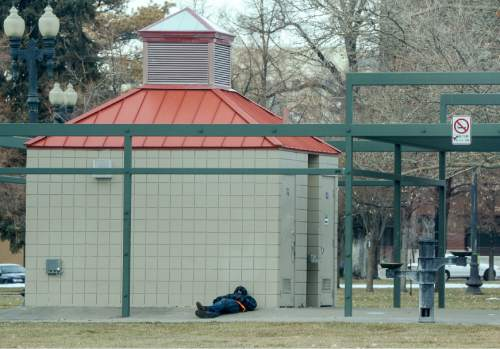 Francisco Kjolseth | The Salt Lake Tribune A regular gathering of homeless frequent Pioneer Park in Salt Lake City on Tuesday. A recent poll story on homelessness tries to answer the questions surrounding funding and responsibility.