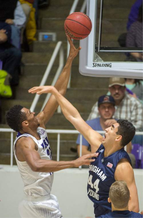 Rick Egan  |  The Salt Lake Tribune  Weber State Wildcats forward Joel Bolomboy (21) scores overBrigham Young Cougars center Corbin Kaufusi (44), in basketball action BYU vs Weber State, at the Dee Events Center in Ogden, Saturday, December 13, 2014