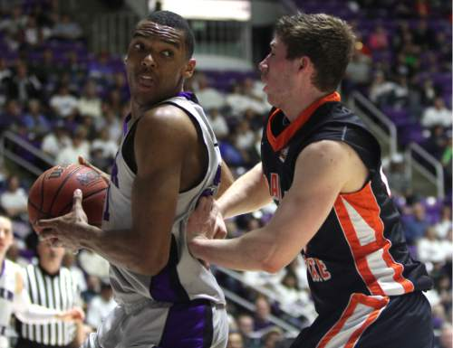Rick Egan  | The Salt Lake Tribune   Weber State Wildcats forward Joel Bolomboy (21) works on Idaho State Bengals guard/forward Chris Hansen (20), in basketball action at the Dee Event Center in Ogden, Monday, February 11, 2013.