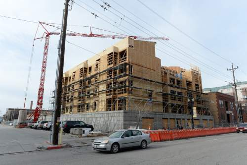 Francisco Kjolseth | The Salt Lake Tribune A new apartment building is constructed West of Pioneer Park in Downtown Salt Lake City. A poll on the Utah economy is tied to new report released on Tuesday.