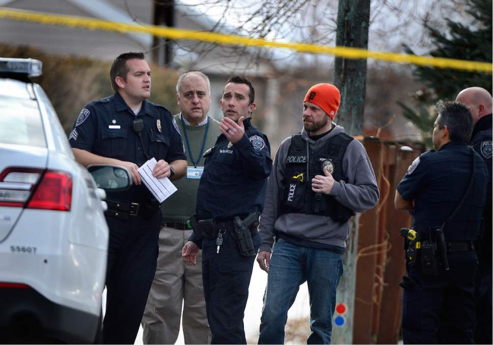 Scott Sommerdorf   |  The Salt Lake Tribune Police talk at the scene of an officer-involved shooting, in Holladay, Sunday, January 17, 2016.