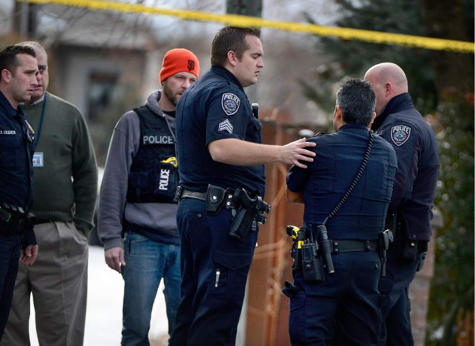 Scott Sommerdorf   |  The Salt Lake Tribune Officer J Lopez gets some supportive attention from officers as they arrive at the scene of an officer-involved shooting, in Holladay, Sunday, January 17, 2016.
