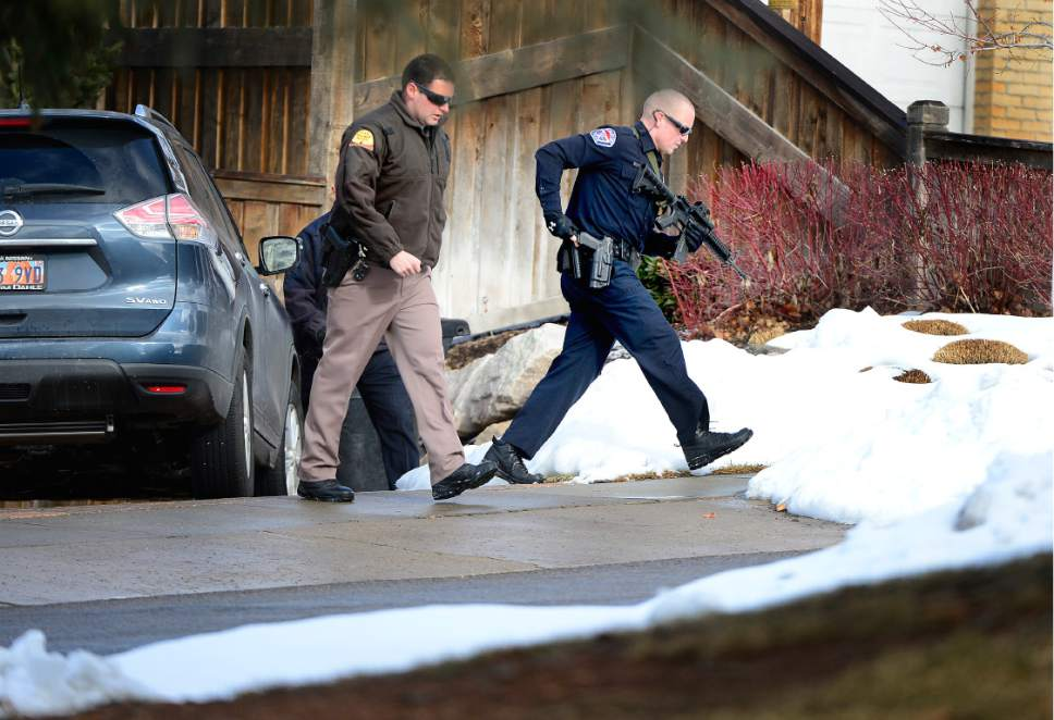 Scott Sommerdorf   |  The Salt Lake Tribune A Unified Police officer works a search of the neighborhood with a UHP officer. Police at the scene of an officer-involved shooting, in Holladay, Sunday, January 17, 2016.
