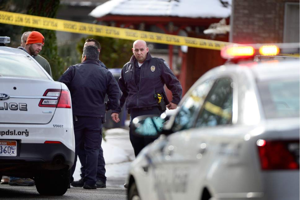 Scott Sommerdorf   |  The Salt Lake Tribune Police at the scene of an officer-involved shooting, in Holladay, Sunday, January 17, 2016.