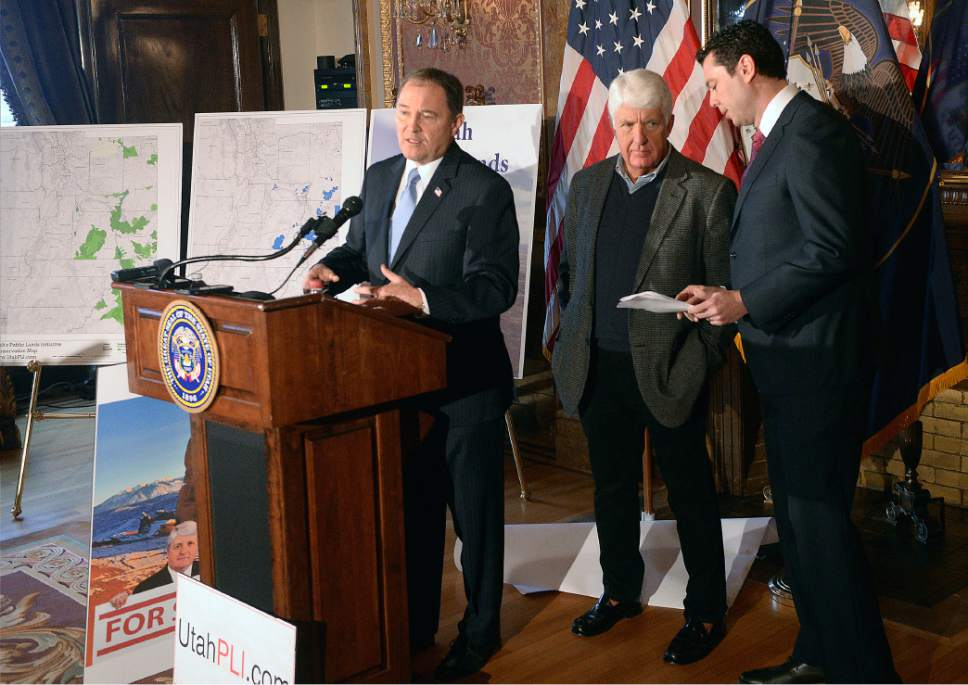 "Al Hartmann  |  The Salt Lake Tribune Utah Governor Gary Herbert, left, speaks in support at unveiling of a ""discussion draft"" of a Public Lands Initiative bill affecting 18 million acres in seven eastern Utah counties at the  Capitol Tuesday Jan. 20. Congressman Jason Chaffetz and bill sponsor Congressman Rob Bishop, right.  Bishop intends on introducing the bill in congress in the next few weeks."