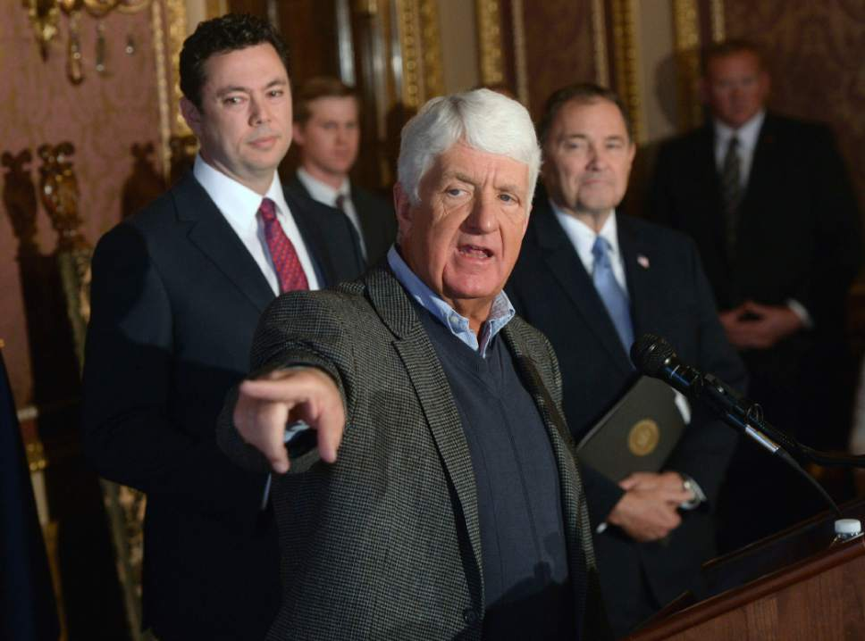 "Al Hartmann  |  The Salt Lake Tribune Utah Congressmen Rob Bishop, center, and Jason Chaffetz, left, with Utah Governor Gary Herbert, right, unveil a ""discussion draft"" of their Public Lands Initiative bill affecting 18 million acres in seven eastern Utah counties at the  Capitol Tuesday Jan. 20.  Bishop intends on introducing the bill in congress in the next few weeks."
