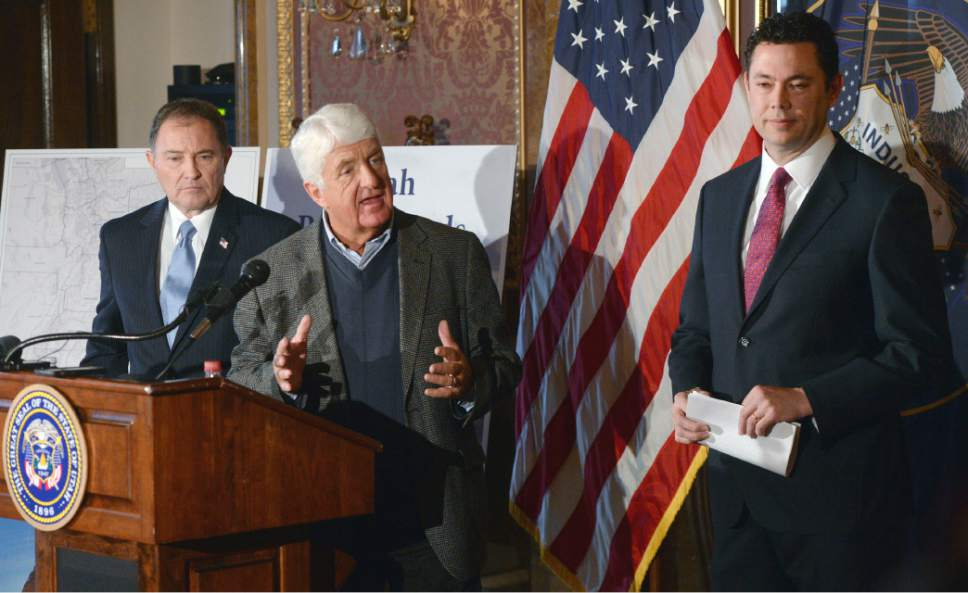 "Al Hartmann  |  The Salt Lake Tribune Utah Congressman Rob Bishop, center, with Utah Governor Gary Herbert, left, and Congressman  Jason Chaffetz, right, unveil a ""discussion draft"" of their Public Lands Initiative bill affecting 18 million acres in seven eastern Utah counties at the  Capitol Tuesday Jan. 20.  Bishop intends on introducing the bill in congress in the next few weeks."