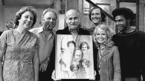 "Norman Lear (center, holding painting) and the cast of ""All In the Family"" -- Jean Stapleton (left), Carrol O'Conner, Rob Reiner, Sally Struthers and Mike Evans.  Credit: CBS"