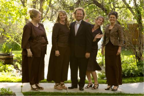 """   Courtesy   Janelle, from left, Christine, Kody Brown, Meri and Robyn, the Utah polygamist family in the new TLC series, """"Sister Wives."""""""