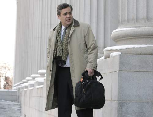 """FILE - In this Jan. 17, 2013, file photo, Jonathan Turley, attorney for Kody Brown and his four wives, the stars of the reality show """"Sister Wives,"""" leaves the Frank E. Moss United States Courthouse, in Salt Lake City. Lawyers for a family made famous by the TV show """"Sister Wives"""" are set to ask a federal appeals court to uphold a ruling that decriminalized polygamy in Utah. The case is scheduled to come before the 10th Circuit Court of Appeals in Denver on Thursday, Jan. 21, 2016. (AP Photo/Rick Bowmer, File)"""