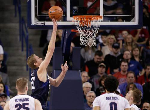 BYU's Kyle Davis (21) shoots in front of Gonzaga's Ryan Edwards, left, Domantas Sabonis, right, and Silas Melson during the first half of an NCAA college basketball game, Thursday, Jan. 14, 2016, in Spokane, Wash. (AP Photo/Young Kwak)