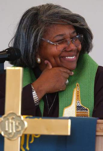Leah Hogsten  |  The Salt Lake Tribune  Rev. Nurjhan Govan is the new pastor at Trinity African Methodist Episcopal Church, a small mostly black church in downtown SLC. September 25, 2005.