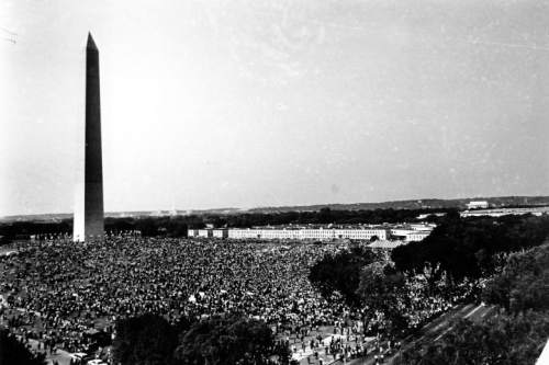 "This general view shows civil rights demonstrators gathered at the Washington Monument grounds before noon on Aug. 28, 1963. The marchers will parade to the Lincoln Memorial, seen in the far background at right, where the March on Washington for Jobs and Freedom will end with Dr. Martin Luther King Jr.'s ""I Have A Dream"" speech. (AP Photo)"