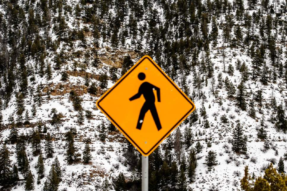 Trent Nelson  |  The Salt Lake Tribune A pedestrian sign at a rock art site in Nine Mile Canyon, Tuesday January 19, 2016.