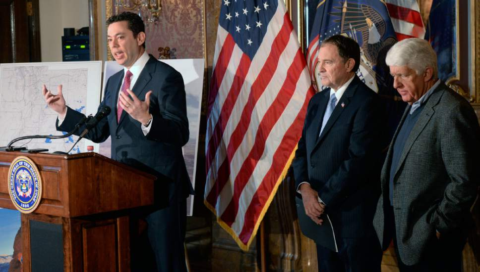 "Al Hartmann  |  The Salt Lake Tribune Utah Congressman Jason Chaffetz, left, speaks in support at unveiling of a ""discussion draft"" of a Public Lands Initiative bill affecting 18 million acres in seven eastern Utah counties at the Capitol Tuesday Jan. 20.  Governor Gary Herbert and bill sponsor Congressman Rob Bishop, right.  Bishop intends on introducing the bill in congress in the next few weeks."