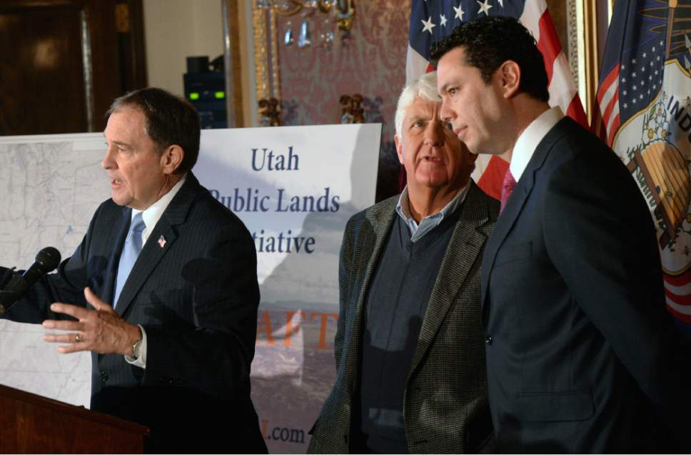 "Al Hartmann  |  The Salt Lake Tribune Utah Governor Gary Herbert, left, speaks in support at unveiling of a ""discussion draft"" of a Public Lands Initiative bill affecting 18 million acres in seven eastern Utah counties at the  Capitol Tuesday Jan. 20 as bill sponsor Congressman Rob Bishop and Congressman Jason Chaffetz talk at right.  Bishop intends on introducing the bill in congress in the next few weeks."