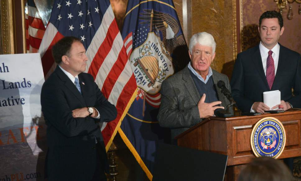"Al Hartmann  |  Tribune file photo Utah Congressman Rob Bishop, center, with Utah Gov. Gary Herbert, left, and Rep. Jason Chaffetz, right, unveil a ""discussion draft"" of their Public Lands Initiative bill affecting 18 million acres in seven eastern Utah counties at the State Capitol Tuesday Jan. 20."