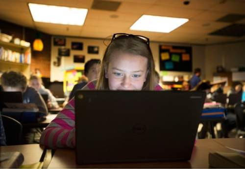 Steve Griffin  |  The Salt Lake Tribune  Brandee Clark, an eighth grader in Melinda Johnston's english class, uses a tablet as the class learns about Anne Frank at Pleasant Grove Junior High School in Pleasant Grove, Utah Thursday, November 12, 2015.