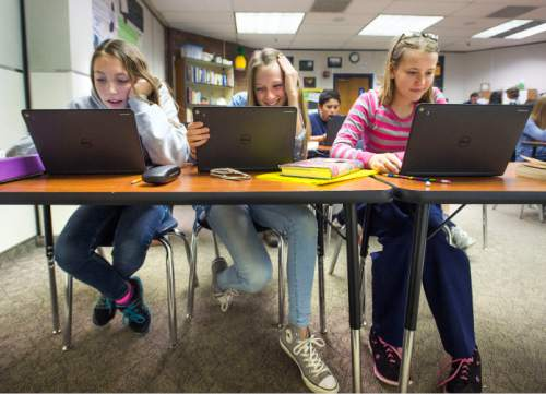 Steve Griffin  |  The Salt Lake Tribune  Eighth graders Julianne Adams, Kandus Hullinger and Brandee Clark, use tablets as they learn about Anne Frank in Melinda Johnston's english class at Pleasant Grove Junior High School in Pleasant Grove, Utah Thursday, November 12, 2015.