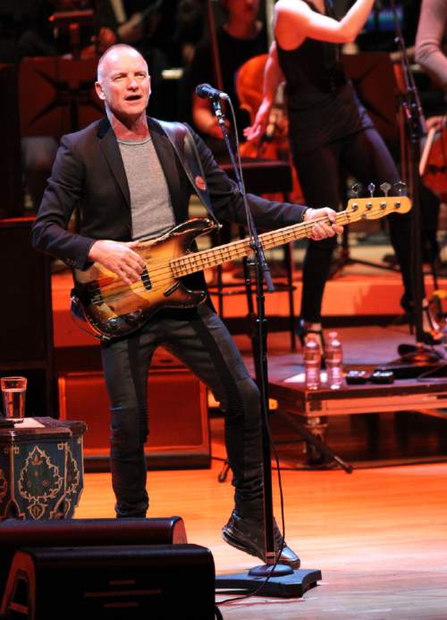 "File-This March 12, 2014, file photo shows Sting performing in concert at the 7th Annual Performance Series of Legends Benefit Concert for The Duke Ellington School of Music at the Music Center at Strathmore in Bethesda, Md. Sting, Idina Menzel and the cast of ""Sesame Street"" will be among the stars celebrating at Macy's Thanksgiving Day Parade. Macy's announced Monday, Nov. 3, 2014, that Kiss, Meghan Trainor, Quvenzhane Wallis and Renee Fleming also will be part of the lineup on Nov. 27. (Photo by Paul Morigi/Invision/AP, File)"