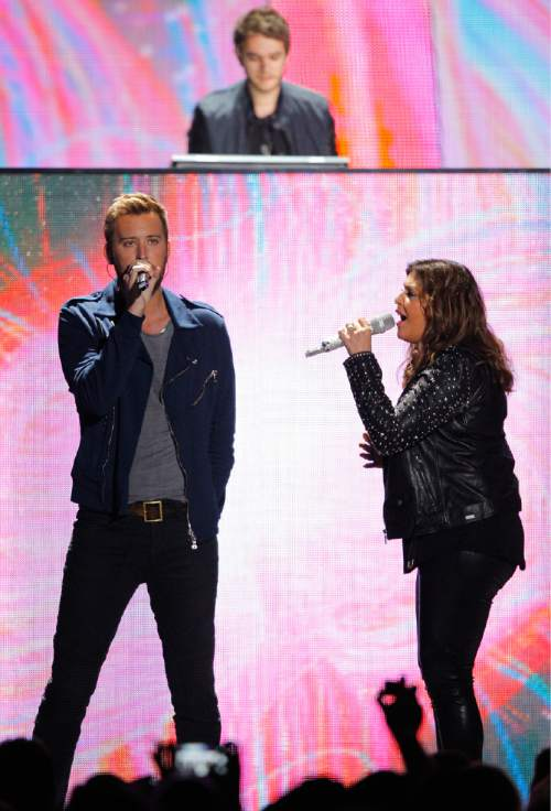 Charles Kelley, left, and Hillary Scott, right, of Lady Antebellum, perform with Zedd at the CMT Music Awards at Bridgestone Arena on Wednesday, June 10, 2015, in Nashville, Tenn. (Photo by Wade Payne/Invision/AP)