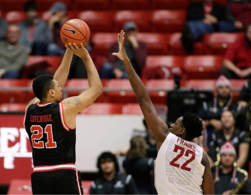 Utah's Jordan Loveridge (21) shoots against Washington State's Robert Franks (22) during the second half of an NCAA college basketball game Thursday, Jan. 21, 2016, in Pullman, Wash. Utah won 92-71. (AP Photo/Young Kwak)