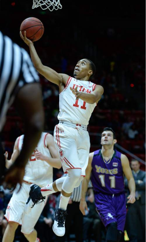 Francisco Kjolseth | The Salt Lake Tribune Utah Utes guard Brandon Taylor (11) sails one in agains the College of Idaho in game action at the Huntsman Center on Monday night in the final non-conference game of the season.