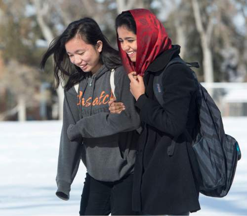 Rick Egan  |  The Salt Lake Tribune  Keziah Gossid and Sonita Alizadeh walk across campus at Wasatch Academy in Mount Pleasant.