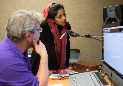 Rick Egan  |  The Salt Lake Tribune  Sonita Alizadeh works on a song in the school recording school with Frank Moody, a mentor  who teaches technology and media literacy classes at Wasatch Academy.