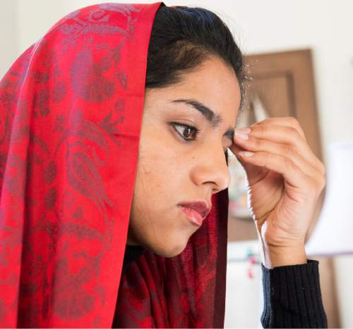 "Rick Egan  |  The Salt Lake Tribune  Sonita Alizadeh works on a research project about women's rights in her ESL class at Wasatch Academy in Mount Pleasant . Alizadeh is an Afghani teenager and rap singer who is the subject of a new documentary at Sundance, ""Sonita."""