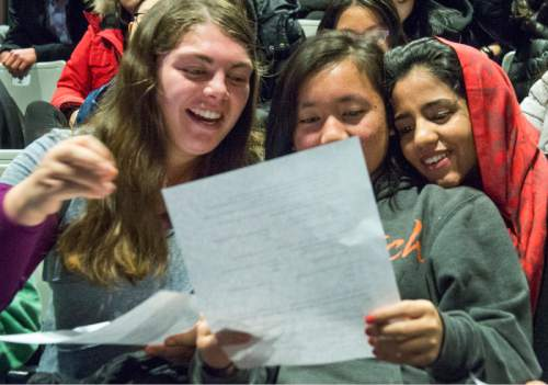 "Rick Egan  |  The Salt Lake Tribune  Christina Perea, Keziah Gossid, and  Sonita Alizadeh, laugh as they look at a dating survey, at Wasatch Academy in Mount Pleasant, Wednesday,  Jan. 13, 2016.  Alizadeh is an Afghani singer who has been at Wasatch Academy in Mount Pleasant, for 1 1/2 years. She is the subject of a new documentary at Sundance, ""Sonita,"""