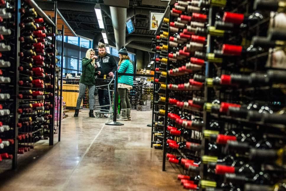 Chris Detrick  |   Tribune file photo The Utah Wine Store, 280 Harris Ave S in Salt Lake City stocks wine in January. Two pieces of legislation would increase funding for the Utah DABC.