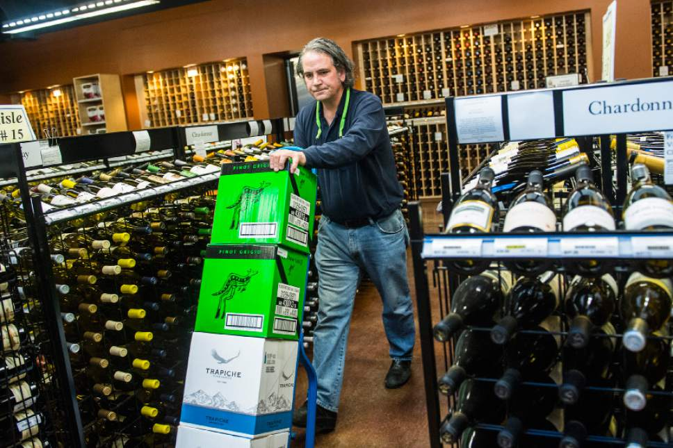 Chris Detrick  |  The Salt Lake Tribune Assistant Manager Warren McClain restocks wine at the Utah Wine Store, 280 Harris Ave S, Salt Lake City, Friday January 22, 2016.