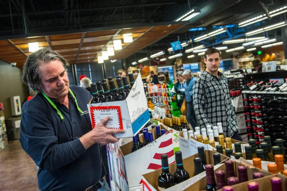Chris Detrick  |  The Salt Lake Tribune Assistant Manager Warren McClain restocks wine at the Utah Wine Store, 280 Harris Ave S, Salt Lake City, Friday January 22, 2016.