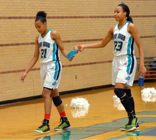 Leah Hogsten  |  The Salt Lake Tribune Twins Monique and Dominque Mills are a driving force for Juan Diego High School's basketball team. Juan Diego High School girls basketball team defeated Morgan High School 75-55, Friday, January 16, 2015.