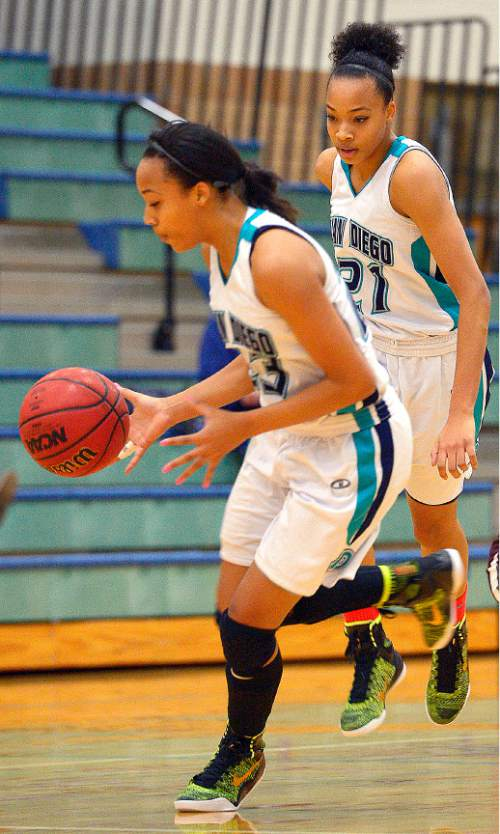 Leah Hogsten  |  The Salt Lake Tribune l-r Twins Dominque and Monique Mills are a driving force for Juan Diego High School's basketball team. Juan Diego High School girls basketball team defeated Morgan High School 75-55, Friday, January 16, 2015.