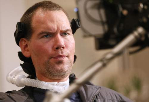 """In this Monday, Jan. 18, 2016, photo, former New Orleans Saints NFL football player Steve Gleason uses eye-tracking technology to communicate an answer during an interview in New Orleans. """"GLEASON,"""" a feature-length documentary that gives an unfiltered look at his life with ALS premieres at the Sundance Film Festival on Saturday. (AP Photo/Jonathan Bachman)"""