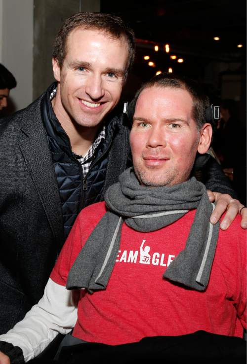 """New Orleans Saint's Quarterback Drew Brees and Steve Gleason at """"Gleason"""" premiere party at Chase Sapphire on Main during the 2016 Sundance Film Festival in Park City, Utah, Jan. 23, 2016. (Photo by Jack Dempsey/Invision for Chase Sapphire Preferred/AP Images)"""