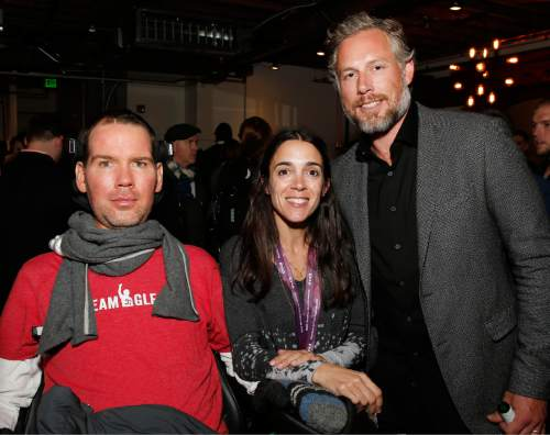 """Steve Gleason, wife Michel and Eric Johnson at """"Gleason"""" premiere party at Chase Sapphire on Main during the 2016 Sundance Film Festival in Park City, Utah, Jan. 23, 2016. (Photo by Jack Dempsey/Invision for Chase Sapphire Preferred/AP Images)"""