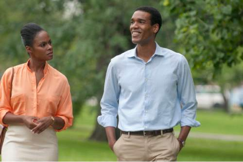 "This image provided by courtesy of the Sundance Institute shows, Tika Sumpter, left, as Michelle Robinson, and Parker Sawyers as Barack Obama, in the film, ""Southside With You,"" directed by Richard Tanne.  The movie is included in the U.S. Dramatic Competition at the 2016 Sundance Film Festival, which runs Jan. 21-31.  (Pat Scola/Sundance Institute via AP)"
